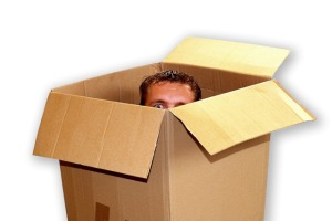 man-peeking-out-of-moving-box